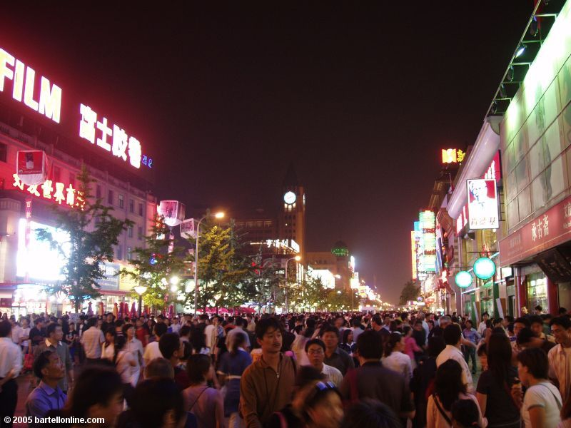 Nighttime crowd on Wangfujing shopping street in Beijing, China