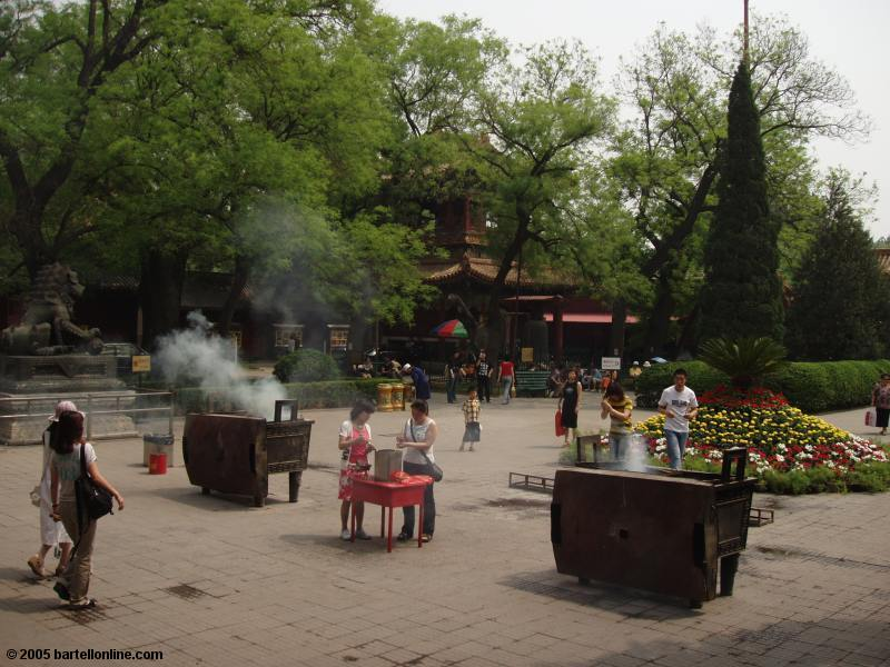 People burning incense at the Lama Temple (Yonghe Lamasery) in Beijing, China