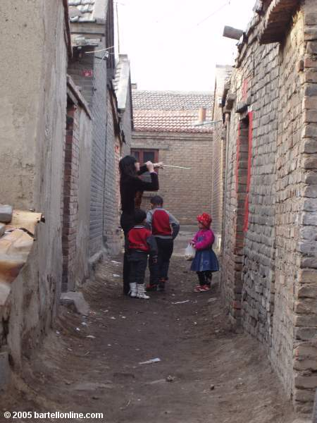 Alley scene in old section of Hohhot, Inner Mongolia, China