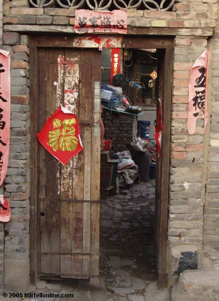 Doorway in alley in old section of Hohhot, Inner Mongolia, China