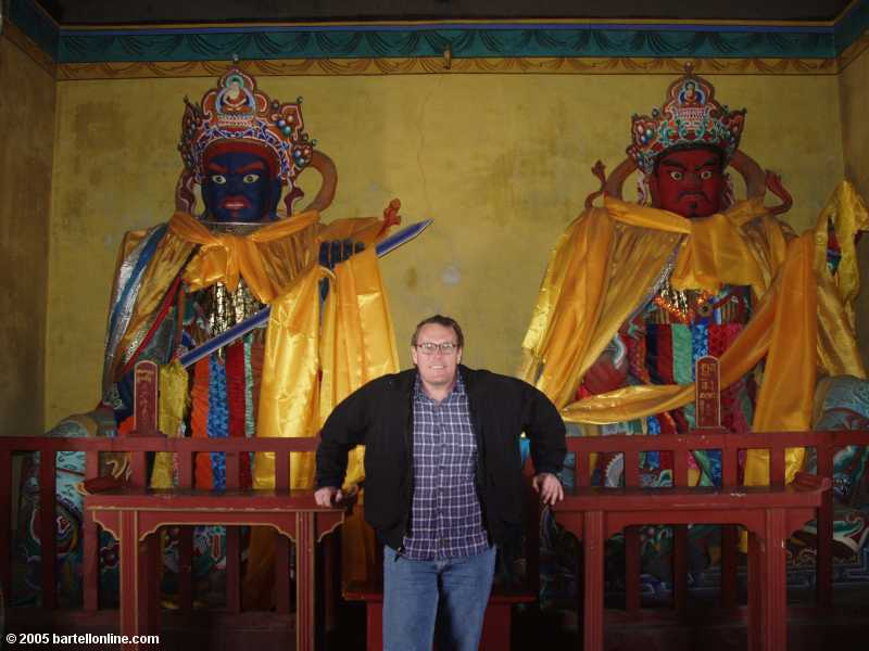 Me with guard figures at Dazhao Temple in Hohhot, Inner Mongolia, China