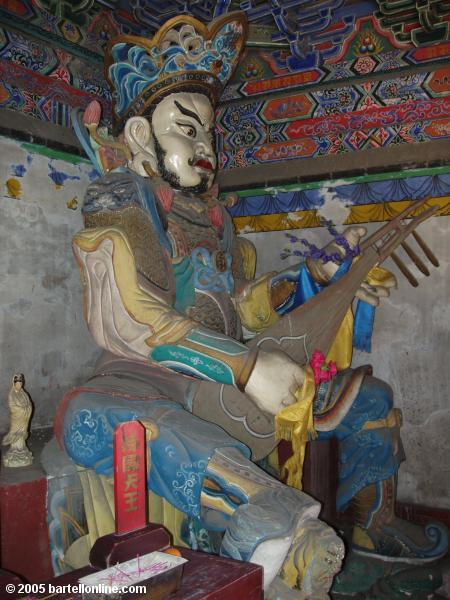 A guardian figure at Xilituzhao Temple in Hohhot, Inner Mongolia, China