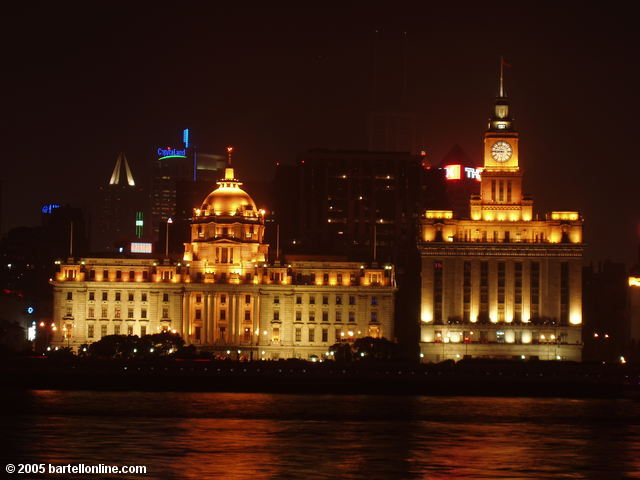 Night view of the Hong Kong and Shanghai Bank and Customs House buildings on The Bund in Shanghai, China