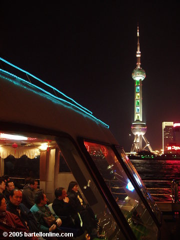 View of the Oriental Pearl TV Tower in Pudong, China as seen from a tour boat on the Huangpu river