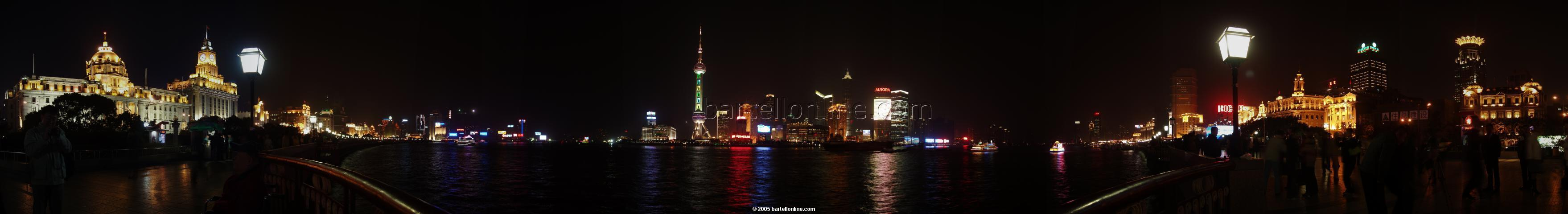 Night panorama of Huangpu river and Pudong seen from The Bund in Shanghai, China