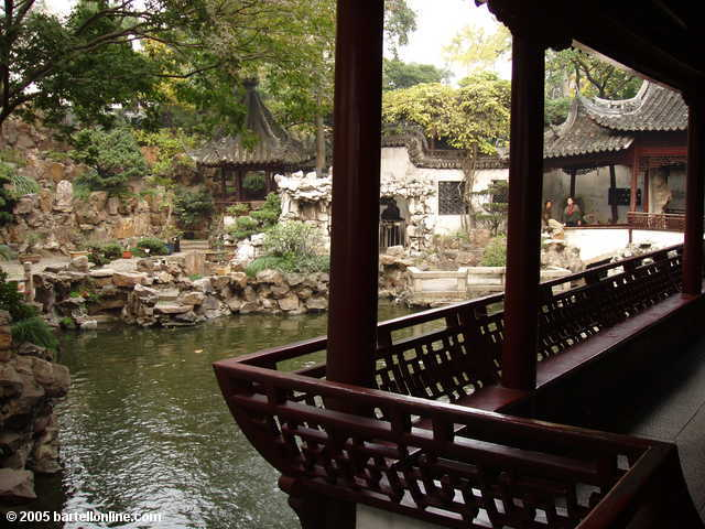 Pond, covered walkway, and building at Yuyuan Garden in Shanghai, China