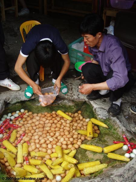 Eggs and corn cooked in natural hotsprings water in the Changbaishan Nature Preserve in Jilin, China