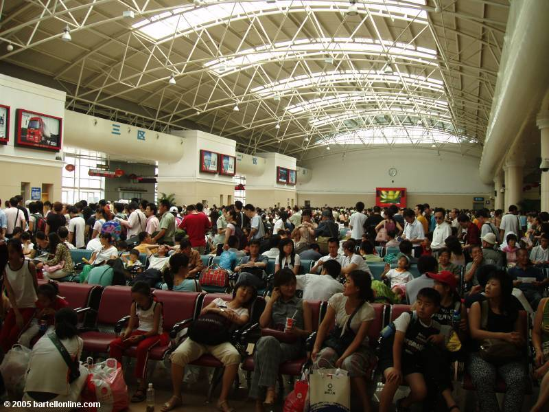 Crowds inside the train station in Dalian, China