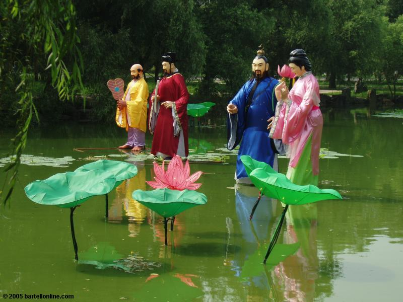 Figures in a pond in Beiling Park, Shenyang, Liaoning, China