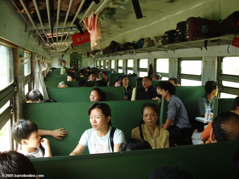 Interior of a typical hard seat car on a passenger train in China