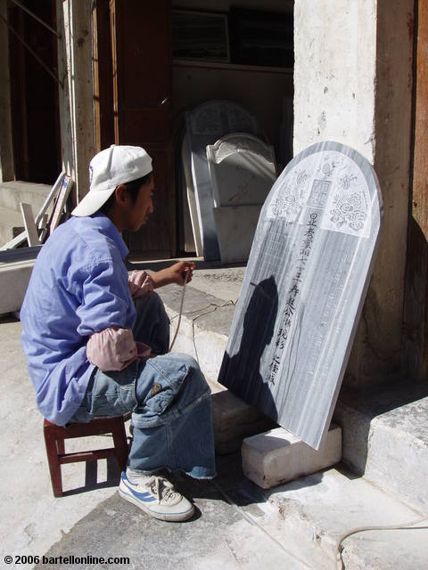 A worker engraves a marble plaque in Dali, Yunnan, China
