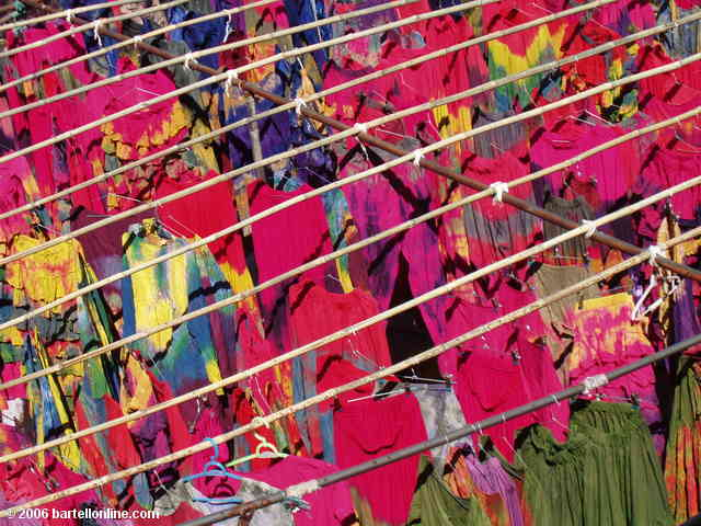 Racks of tie-dyed clothing dry at a factory in a village outside Dali, Yunnan, China