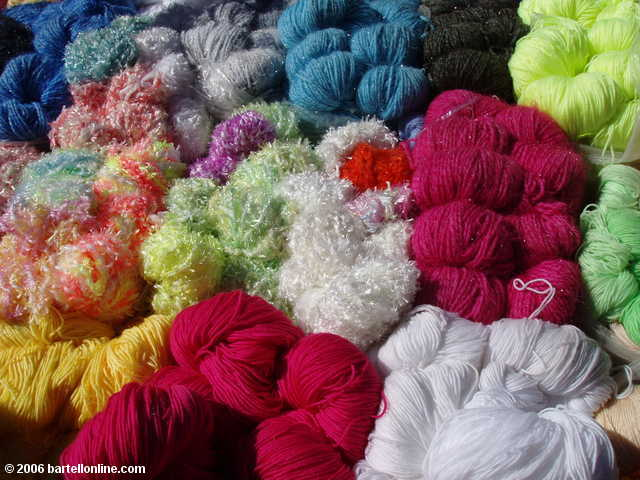 Colorful yarn for sale at the Youshuo market in Yunnan province, China