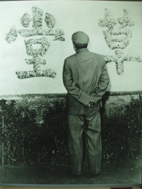 Museum photo of Mao Zedong posing by the Stone Wall at Du Fu's Thatched Cottage in Chengdu, Sichuan, China