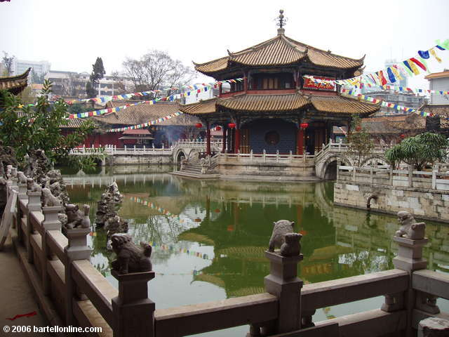 An octagonal temple to Guanyin rises from a pool inside Yuantong Temple in Kunming, Yunnan, China