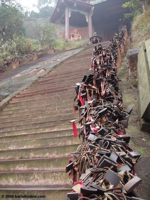 Padlocks on a stairway handrail in the Giant Buddha scenic area in Leshan, Sichuan, China