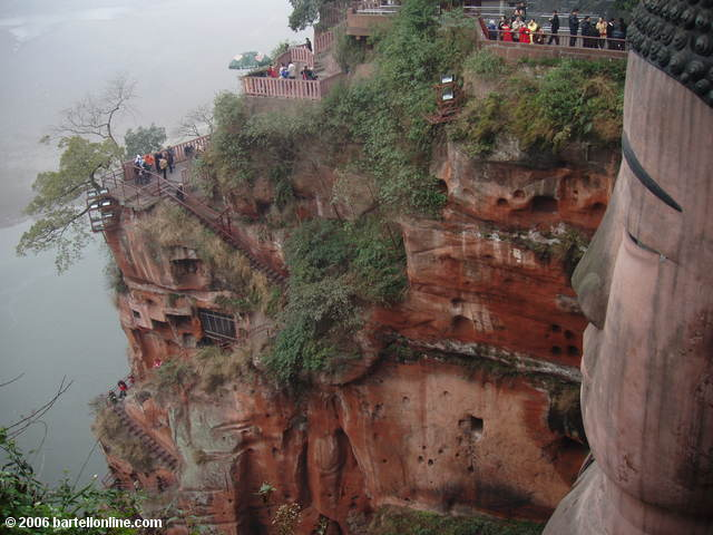 Narrow stairs wind down the cliff beside the Giant Buddha in Leshan, Sichuan, China