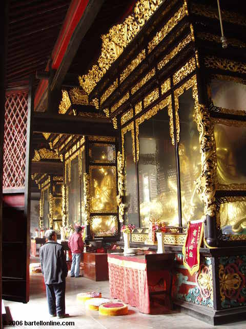Encased statues in the Hall of Three Purities at Qingyang Temple in Chengdu, Sichuan, China