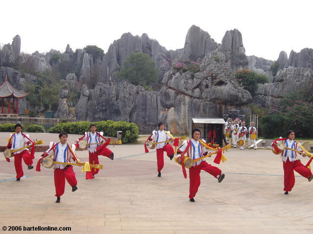 Costumed dancers at the Stone Forest near Kunming, Yunnan, China
