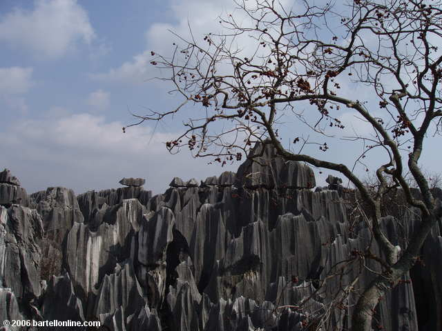 A small pavilion rises above the limestone karsts at the Stone Forest near Kunming, Yunnan, China
