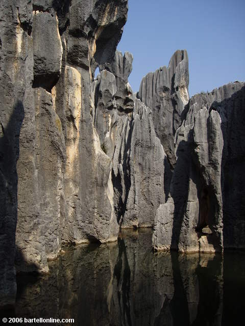Limestone karsts surround the Sword Pool at the Stone Forest near Kunming, Yunnan, China