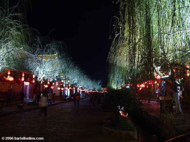 Lighted trees line a street in the Old Town of Lijiang, Yunnan, China