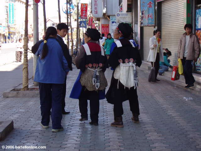 Women in ethnic dress on the streets of Lijiang, Yunnan, China