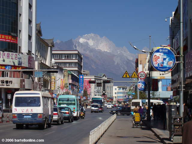Jade Dragon Snow Mountain looms above the new town streets of Lijiang, Yunnan, China