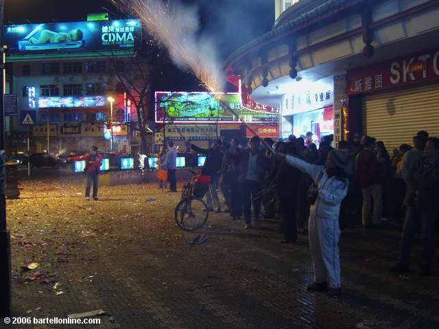 People celebrate the Lunar New Year with fireworks on a street in Lijiang, Yunnan, China