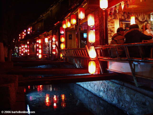 Night view of a restaurant beside a canal in the Old Town of Lijiang, Yunnan, China