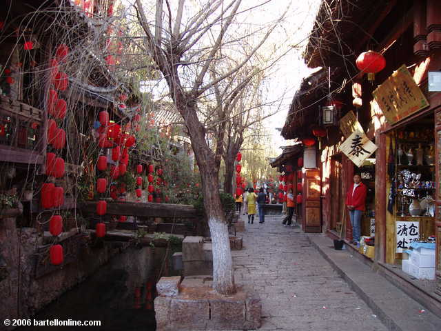 Souvenir shops along a canal in the Old Town of Lijiang, Yunnan, China