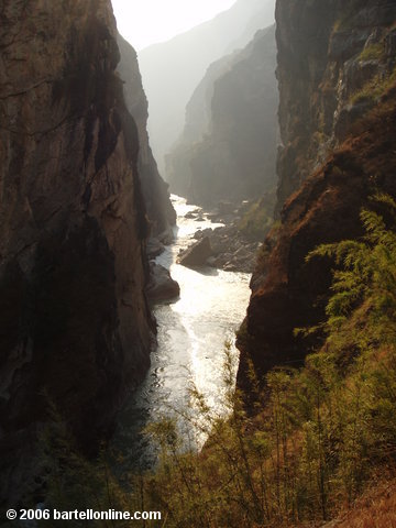 View of cliffs and the Jinsha River (which later becomes the Yangtze) in a narrow section of Tiger Leaping Gorge in Yunnan, China