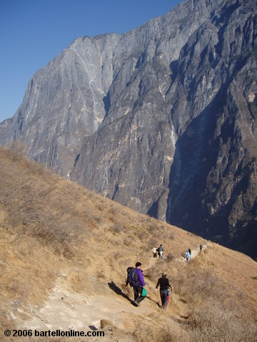Backpackers descend down towards the road from the upper trail through Tiger Leaping Gorge in Yunnan, China