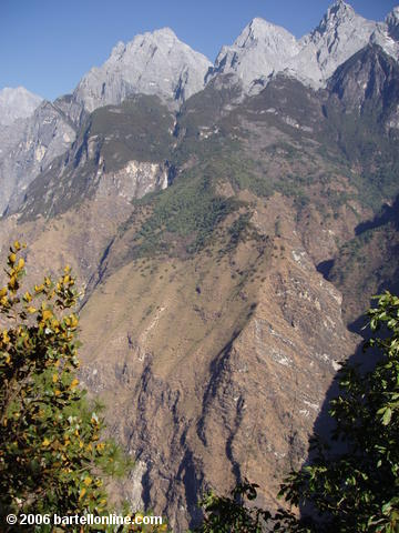 View of Jade Dragon Snow Mountain from the upper trail through Tiger Leaping Gorge in Yunnan, China