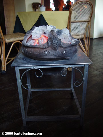"Charcoal tableside heater in a restaurant in Zhongdian (""Shangri-La""), Yunnan, China"
