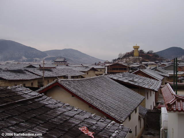 "Light dusting of snow on the roofs of Zhongdian (""Shangri-La""), Yunnan, China as seen from the Tibetan Hotel"