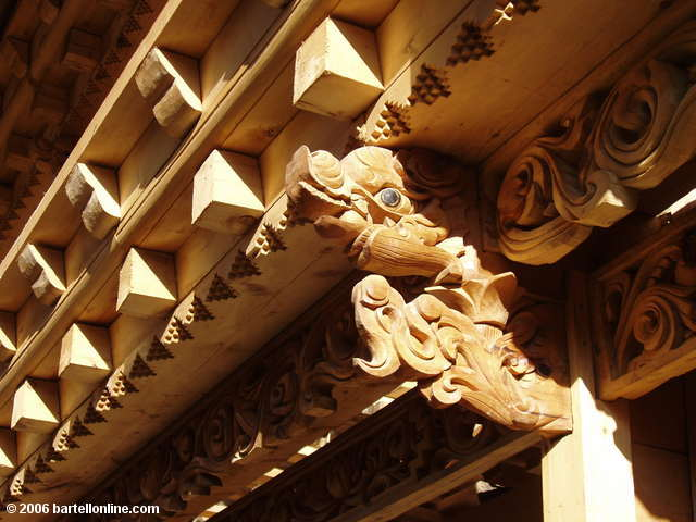 "Detail of new wood carving on a building in the old town section of Zhongdian (""Shangri-La""), Yunnan, China"